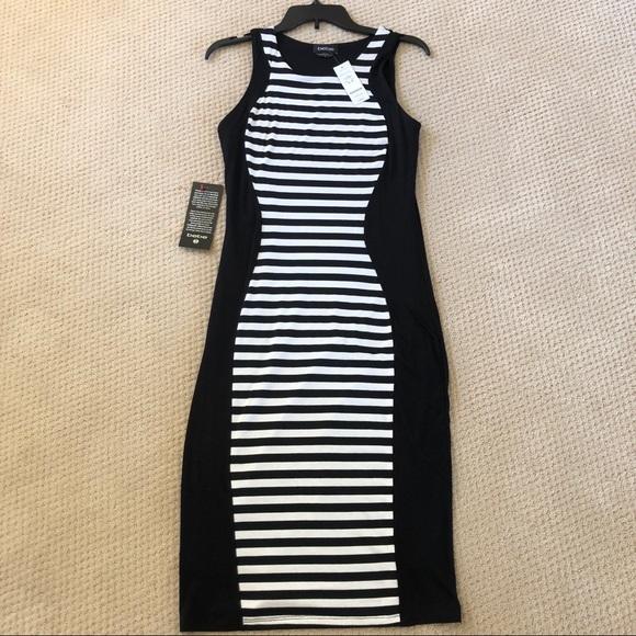 bebe Dresses & Skirts - Bebe Black & White stretch knit dress